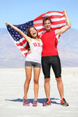 Cheering people athletes holding american USA flag — Stock Photo