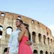 Romantic couple on travel in Rome by Coliseum. — Stock Video #32410371