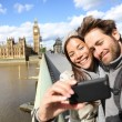 London tourist couple taking photo near Big Ben — Stok fotoğraf
