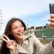 Asian tourist in London taking self-portrait photo — Stock Photo