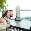 Happy couple by Tower Bridge, River Thames, London — Stock Photo #33031997