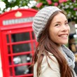 Stock Photo: London people - woman by red phone booth