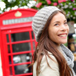 Stock Photo: London people - womby red phone booth