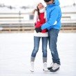 Ice skating couple on date in love iceskating — Stock Photo