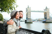 Happy couple by Tower Bridge, River Thames, London — Stock Photo