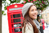 London people - woman by red phone booth — Stock Photo