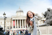 London tourist woman on Trafalgar Square — Stock Photo
