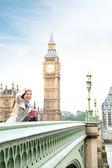 London woman happy by Big Ben — Stock Photo