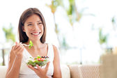Healthy lifestyle woman eating salad smiling happy — Foto de Stock