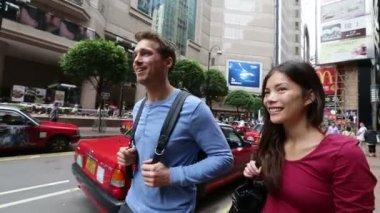 Hong Kong Times Square Causeway Bay couple walking — Stock Video