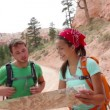 People hiking looking at hike map in Bryce Canyon — Stock Video #33041741