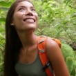 Hiking woman trekking in forest standing looking — Stock Video