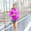 Running woman jogging in New York City — Stock Photo