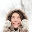 Winter woman looking up happy and smiling — Stock Photo #34123121