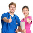 Nurse and doctor team happy thumbs up — Zdjęcie stockowe