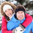 Winter couple happy piggyback — Stock Photo