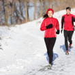 Winter running exercise couple — Stock Photo