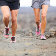 Trail running - close up of runners shoes and legs — Stock Photo #34123355