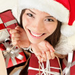 Christmas gifts santa woman shopping — Stok fotoğraf