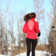 Winter running woman in snow — Stock Photo