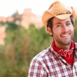 Cowboy man smiling happy wearing hat in country — Photo