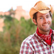 Cowboy man smiling happy wearing hat in country — Stok fotoğraf