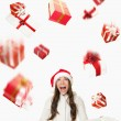 Christmas Santa woman - raining gifts — Stock Photo