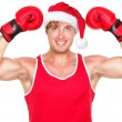 Christmas fitness boxer wearing santa hat — Stock Photo