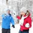 Winter fun - couple in snowball fight — Stok fotoğraf