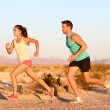 Stock Photo: Cross-country trail running people at sunset
