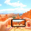 Smartphone taking photo of Bryce Canyon nature — Stock Photo #34123931