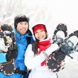 Winter couple outdoors on snowshoes — Stock Photo