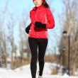 Sport woman running in winter — Stockfoto