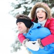 Winter couple happy piggyback — Stok fotoğraf