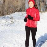 Winter snow runner woman — Stock Photo #34124003