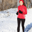 Winter snow runner woman — Stock Photo