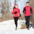 Sport couple running in winter — Stock Photo