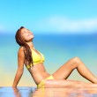 Sunbathing woman relaxing under sun in luxury spa — Stock Photo