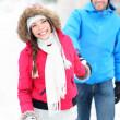 Happy winter couple in snow — Stock Photo