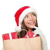 Christmas shopping woman thinking — Stock Photo