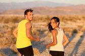 Exercise - couple running looking happy — Stock Photo