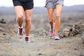 Trail running - close up of runners shoes and legs — Stock Photo