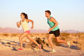 Cross-country trail running people at sunset — Stock Photo