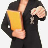 Real estate agent holding keys — Stock Photo