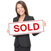 Realtor, Real estate agent woman sold sign — Stock Photo