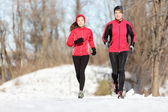 Sport couple running in winter — Stock Photo