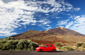 Car on road trip to freedom — Stock Photo