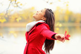 Happy autumn woman blissful — Stock Photo