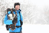 Winter snowshoeing man — Stock Photo