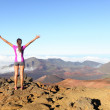 Hiking woman on top happy and celebrating success — Stock Photo